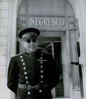 A police officer in front of The Hotel Negresco in Nice, France.