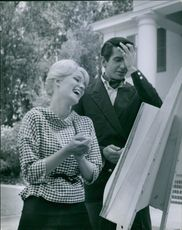 Yvette Mimieux and George Hamilton (actor) painting.