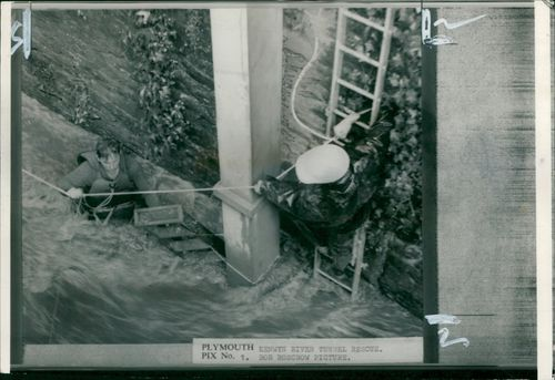 Floods 1966-1989:A fireman rescuing one of five cornish workmen.