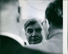 Bevan the sought-after statesman and public figure. He listens gravely to two local labour officials.