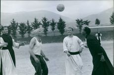 Raf Vallone (center), wearing a prosthetics on his head, seen playing ball with three men during their break on the set of their movie.