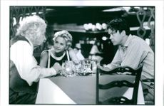 A scene showing Walter Matthau, Meg Ryan and Tim Robbins in I.Q.