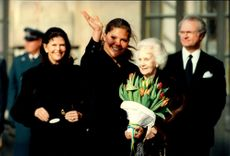 Crown Princess Victoria waves happily on her name's day, in the background is Queen Silvia, Princess Lilian and King Carl XVI Gustaf