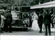 People eagerly wait outside until the end of the wedding ceremony to see Prince Edward, Duke of Kent and wife Katharine as they get to their car.  - Jun 1961