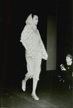 A crew in knitted garment with white dots of Kenzo on the catwalk during a fashion show