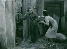 A scene from movie 'Thunder and Lightning (1938 film)'.  Language: Swedish.  Thunder and Lightning (Swedish:Blixt och dunder) is a 1938 Swedish comedy film directed by Anders Henrikson .