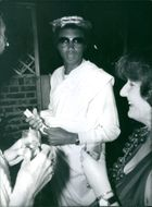 Arthur Ashe resting in his laurel leaves and dark glasses; attended the celebration of Roman Holiday.