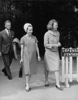 Princess Irene of the Netherlands (right) walking along with a guest, 1964.