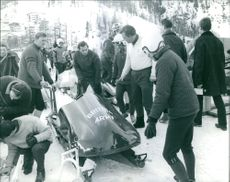 Mikael av Kent or Prince Michael of Kent(center) with his friends for ice skiing hobby in this photo.