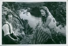 "Jarl Kulle and Anita Björk in a scene from the movie 1956 Swedish drama film, ""Song of the Blood-Red Flower""."