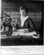 Writer Agnes von Krusenstjerna writing on Fröknar von Pahlen on loggian to a farm in Sweden