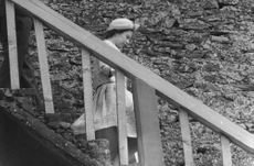 Princess Anne coming down the stairs.