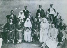 """Elsa Brandstrom photographed with a group of people.   """"Elsa Brandstrom Standing in second row Swedish association hospital in Petrograd""""  1914"""