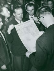 Anton Geesink reading newspaper. Photo taken Dec 11, 1961
