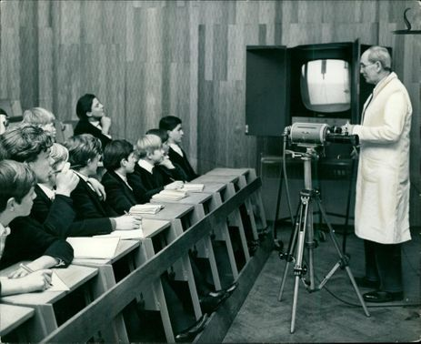 Dr Jack Goodeyear as he delivers a lecture on radio activity.