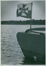A flag waving on the boat in Sweden during the war time.