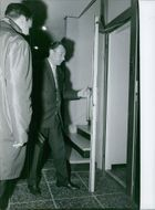 Two men going out of the room, 1964.
