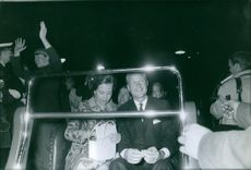 Princess Benedikte and Prince Richard sitting togeter during an event and smiling.