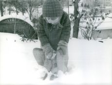 A kid enjoying the snow.