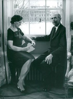 Sir Alec Douglas-Home with his wife is sitting at the window at no. 10 Downing Street
