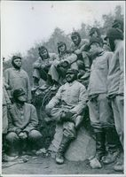 A group of soldiers having a conversation.