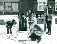 Princess Margriet of the Netherlands skiing with people.