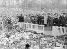 People gathered and paying their respects to John F. Kennedy at his funeral.