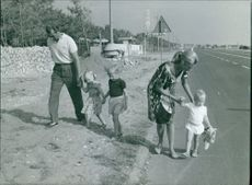 Albert II of Belgium walking roadside with his wife Queen Paola of Belgium and children.
