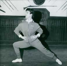 Italian actress Silvana Pampanini is making preparatory gymnastics before starting her fencing lesson.
