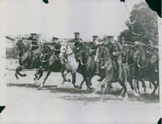 Soldiers were marching forward on riding horse, 1935.