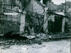 A soldier speaking on a radio, in a building wreckage caused by the war in Vietnam. June 16 1968.
