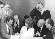 Yul Brynner enjoying with friends.