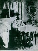An wounded man sitting in a wheel chair.