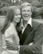 """Barbara Bach and Roger Moore at Pinewood Studios in front of the recordings of the James Bond movie """"Loved Spy"""""""