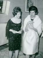 Princess Soraya with woman at an event in Italy.