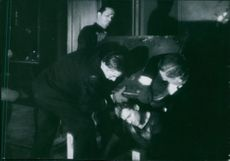"""Jules Dassin, Jean Servais, Robert Manuel and Carl Möhner in a scene from the film called """"Rififi"""" in 1955."""
