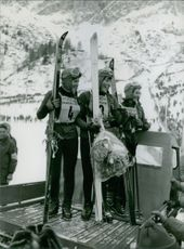 Christine Béranger-Goitschel standing and smiling together with other skier and .Photo taken on Feb. 12, 1964.