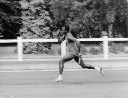 A man running during a competition for 100 meters world record, 1967.