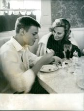 Michele Morgan having breakfast with her son.