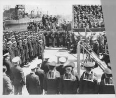 Rear Admiral Adolphus Andrews (at microphones), 3rd Naval District Commandant and Chief of North Atlantic Naval coast patrol reads orders to Capt/ M. Hustvedi, commander of the newly commissioned U.S.S. North Carolina.