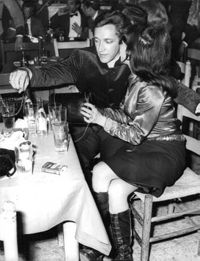Pascale Petit with a man at a party.