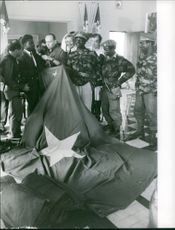 Soldiers with hug flag.