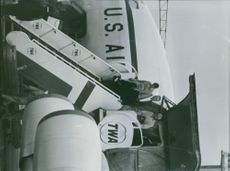 William Averell Harriman stepping down from airplane. 1968