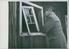A soldier looking at the window. 1945.