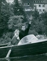 Man with woman in boat.