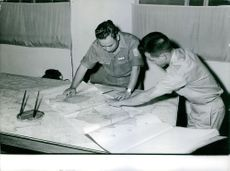 Soldiers looking at map.