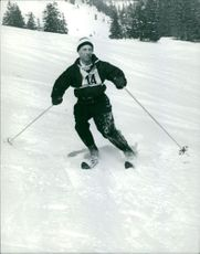 A man skiing on snow.