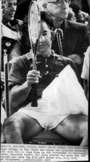 Bobby Riggs is breathing out during the break of the tennis match against Billie Jean King at the Astrodome Arena.