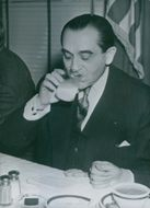 Pierre Mendes drinking a glass of milk.