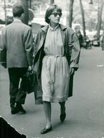 Greta Garbo walking on a street